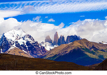 Incredible clouds of the southern hemisphere. The magnificent park of Torres del Paine. Travel to Biosphere Reserve in Patagonia. The concept of extreme tourism and photo tourism