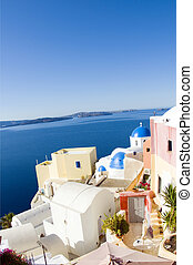 incredible santorini with cobble stone street flowers and...
