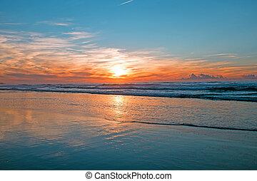 Incredible sunset at the atlantic ocean in Portugal