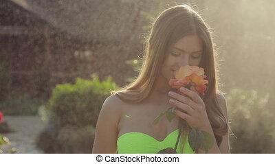 Incredibly cute girl with long hair wearing a bikini...