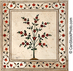 Incrustation from semiprecious stones in the form of a flower on walls of Taj Mahal, India.