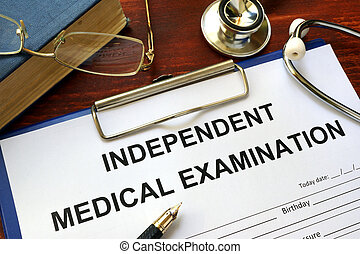 Independent Medical Examination (IME) form on a wooden...