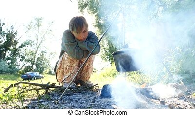 Independent young traveler woman hiker, keeping warm and...