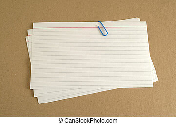 Index Cards on Folder - Paper clip holding three index cards...