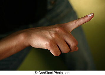 Index finger on a green dim background