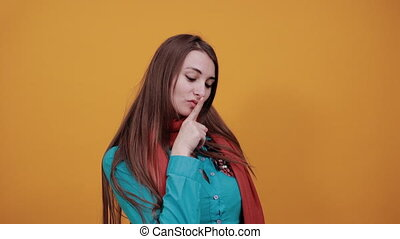 Index finger on lips, silence gesture, shhh quiet, asks for ...