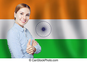 India concept. Happy woman with thumb up on the India flag background. Travel and learn hindi language