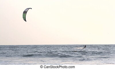 INDIA GOA Arambol beach February 21, 2013. Kiteboarder enjoy...