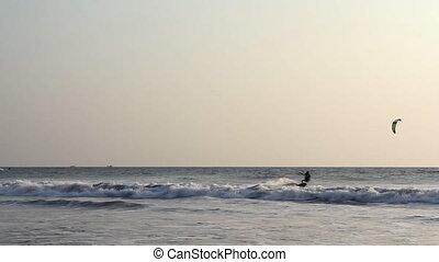 INDIA GOA Arambol beach February 21, 2013. Kiteboarder enjoy...