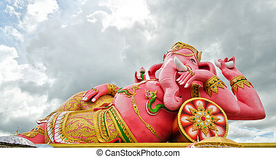 Big pink Ganesha statue in relaxing action, Thailand.