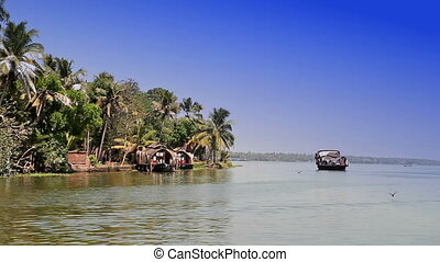 India. Houseboat on Kerala backwaters. Landscape in a sunny...