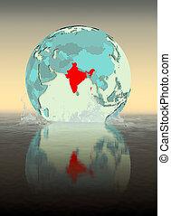 India on globe splashing in water