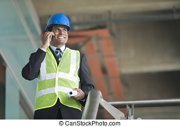 Indian Architect or engineer at work. - Portrait of a male...