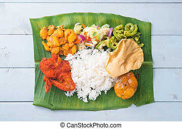 Indian banana leaf rice on table