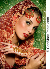 Indian Beauty - Indian woman laying in luxe ethnic interior.