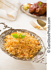Indian biryani rice and curry with backgrounds