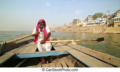 indian boatman at varanasi ganga river