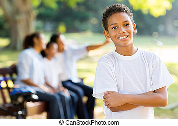 indian boy in front of family outdoors