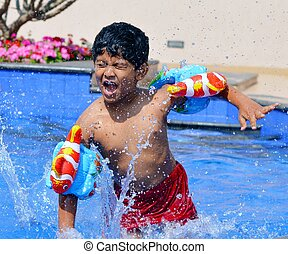 Indian Boy in Swimming practice - An Indian boy of age 6-7...