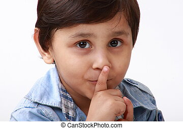 Indian boy indicating to keep quiet