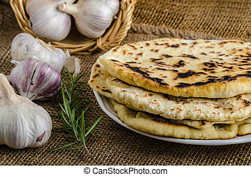Indian bread naan - Indian bread with rosemary, garlic and...
