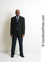 indian business man in a coat