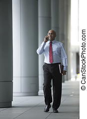 Indian Business man Outside Office using his Mobile Phone.