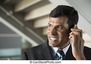Indian business Man using his Smart phone.