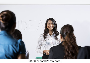 Indian business woman giving presentation - Business leader...