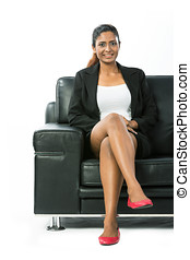 Indian Business woman sitting on a chair.