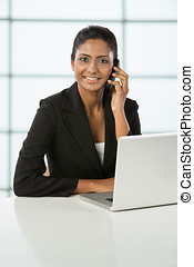Indian business woman using a mobile phone.