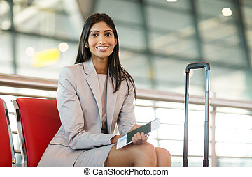 indian business woman waiting at airport