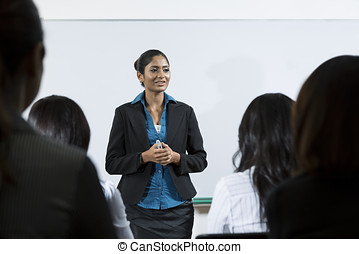 Indian businesswoman giving a lecture - Indian business ...