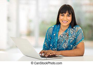 indian businesswoman using laptop