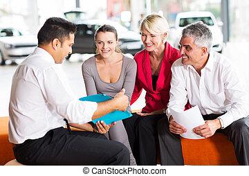 indian car dealer explaining sales contract