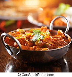 indian chicken vindaloo curry in balti dish with lens flare