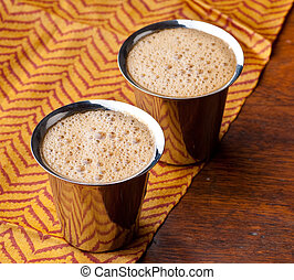 Indian coffee background - Frothy South Indian coffee served...