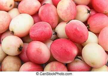 Indian common herb Koromcha - Karonda or Carissa carandas use as fruit background