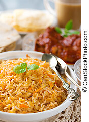 Indian cuisine biryani rice and chicken curry.
