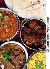 Indian curries from above - A close-up view of bowls of...
