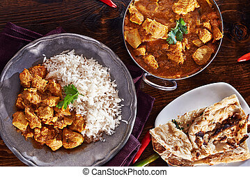 indian curry meal with balti dish, naan, and basmati rice