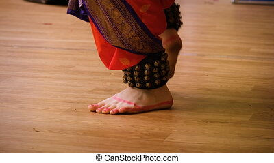 Indian dancing on stage - Indian dance. women's feet in...