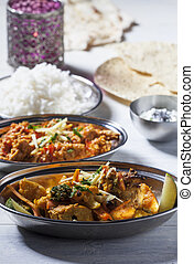 indian dishes with rice on wood