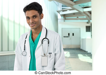 Indian Doctor standing outside a hospital.