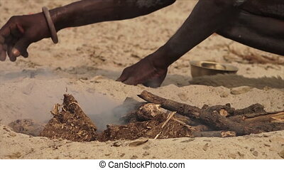 Indian Dom preparing a funeral Pyre, Ganges, India - Extreme...