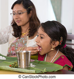Indian family eating dinner at home