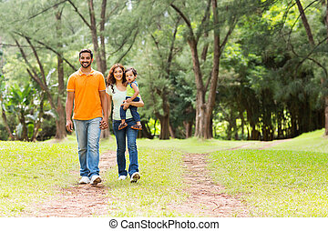indian family going for a walk in forest