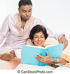 Indian family reading book together