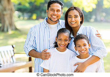 indian family standing at the park
