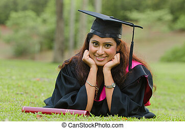 indian female graduate with green background